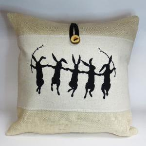 Burlap throw pillow with rabbit har..